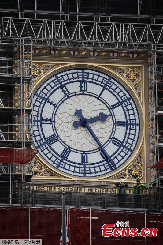 Photo taken on March 22, 2019 shows part of the clock tower revealed for the first time since restoration work began in 2017. And it shows a mostly blue face. (Photo/Agencies)