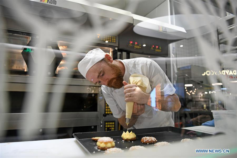 French baker Christophe makes desserts at his bakery store in Guangzhou, south China\'s Guangdong Province, March 21, 2019. French baker Christophe and his wife Agnes started their first French bakery store called \