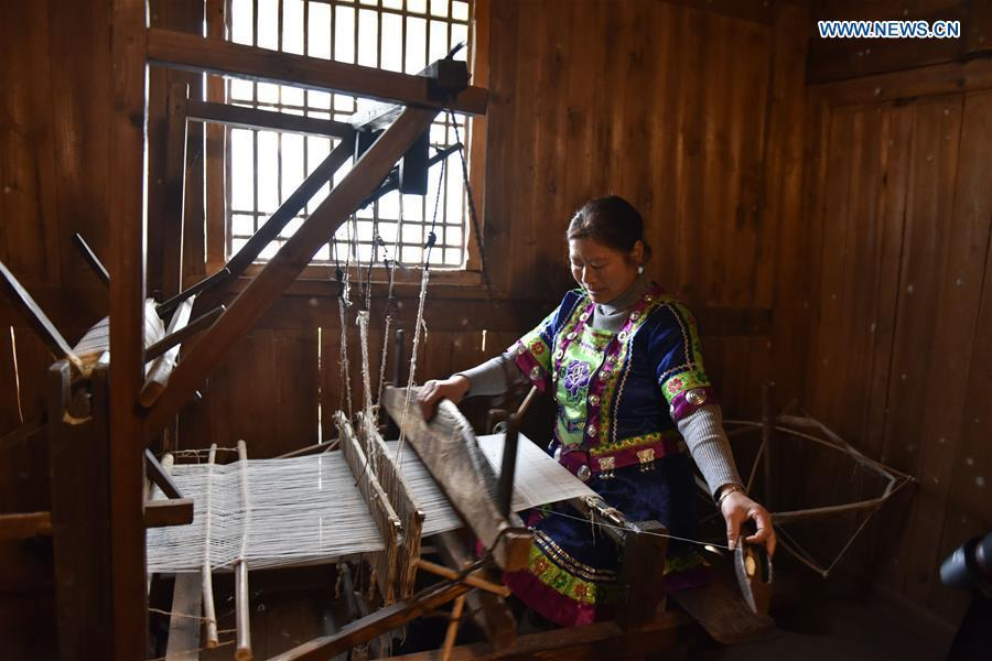 A woman of Dong ethnic group weaves cloth at Laozhai Village of Yuping Dong Autonomous county of Tongren, southwest China\'s Guizhou Province, March 23, 2019. Traditional Dong cloth making has a long history. The procedure includes planting cotton, spinning, weaving, dyeing, etc. And the cloth enjoys lasting popularity among the people of Dong ethnic group. (Xinhua/Long Mengqian)