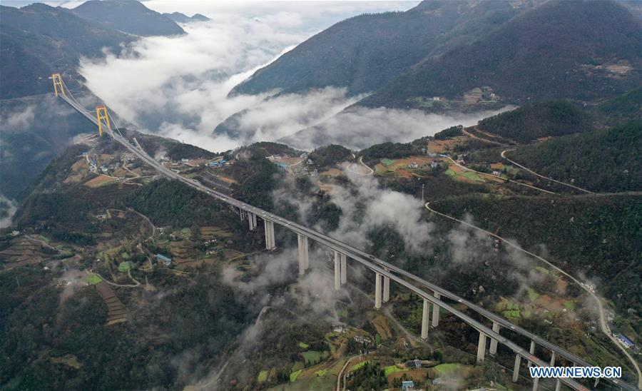 This aerial photo taken on March 23, 2019 shows the Siduhe Bridge on the Shanghai-Chongqing Highway in Yesanguan Town of Badong County in Enshi Tujia and Miao Autonomous Prefecture, central China\'s Hubei Province. The Siduhe Bridge, built 90 meters high and 560 meters up from the valley bottom, forms a landscape in Enshi. (Xinhua/Yang Shunpi)