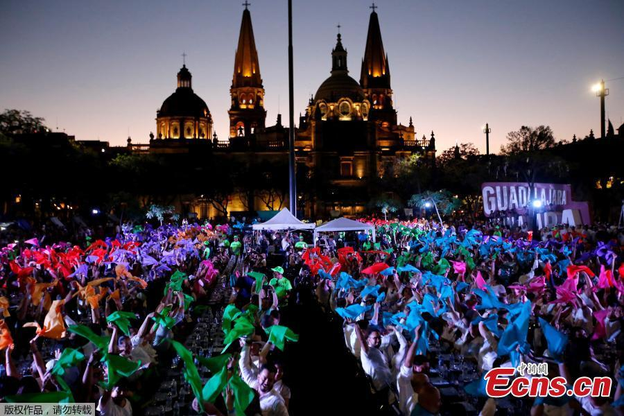 1,486 people hold a tequila tasting at the Plaza Liberacion in Guadalajara, Jalisco, Mexico, on March 24, 2019 in an attempt to set a new Guinness World Record for the \