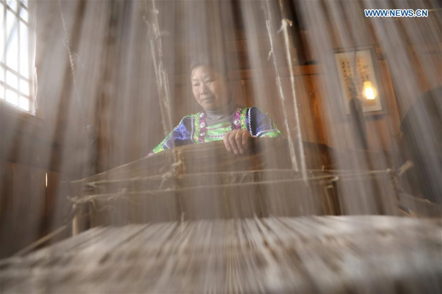 A woman of Dong ethnic group weaves cloth at Laozhai Village of Yuping Dong Autonomous county of Tongren, southwest China\'s Guizhou Province, March 23, 2019. Traditional Dong cloth making has a long history. The procedure includes planting cotton, spinning, weaving, dyeing, etc. And the cloth enjoys lasting popularity among the people of Dong ethnic group. (Xinhua/Wang Changyu)