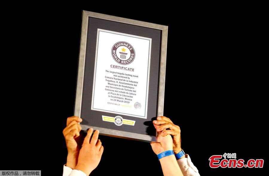 The Guinness World Record Officer Natalia Ramirez delivers the certificate for \