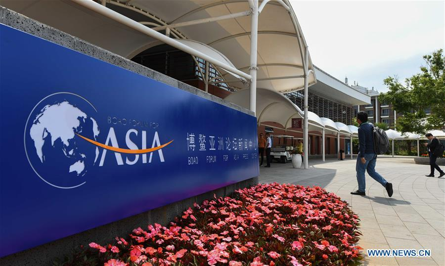 A journalist walks into the media center in Boao Town of Qionghai City, south China\'s Hainan Province, March 25, 2019. The BFA annual conference will be held in Boao from March 26 to 29 under the theme of \