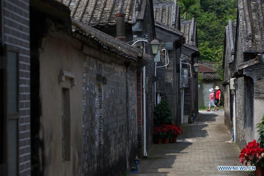 People visit Nanqiang Village in Boao Town, Qionghai City, south China\'s Hainan Province. Qionghai City has quickened its steps towards the construction of \