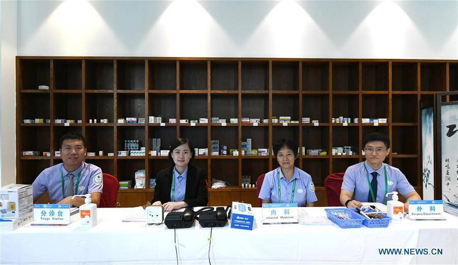 Medical staff of the Boao Forum for Asia (BFA) are seen on duty in Boao Town of Qionghai City, south China\'s Hainan Province, March 25, 2019. The BFA annual conference will be held in Boao from March 26 to 29 under the theme of \