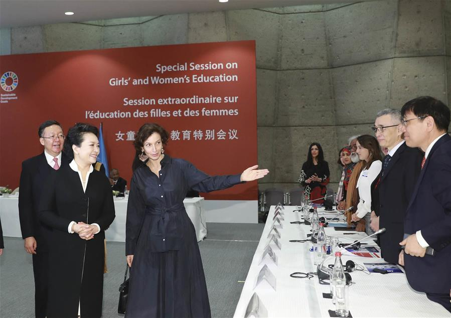 Peng Liyuan, wife of Chinese President Xi Jinping, and UNESCO special envoy for the advancement of girls\' and women\'s education, attends the special session on girls\' and women\'s education in Paris, France, March 26, 2019. (Xinhua/Ding Lin)