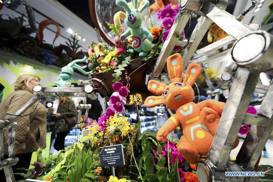 People visit Macy\'s Flower Show at Macy\'s Herald Square flagship store in New York, the United States, on March 25, 2019. The annual flower show is held from March 24 to April 7 this year. With the theme of \