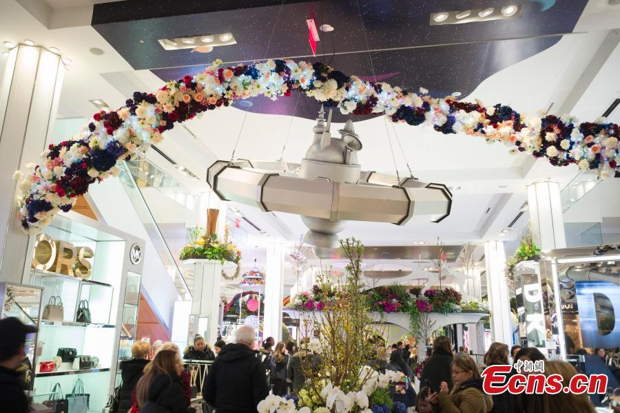 People visit Macy\'s Flower Show at Macy\'s Herald Square flagship store in New York, the United States, on March 26, 2019. The annual flower show is held from March 24 to April 7 this year. With the theme of \