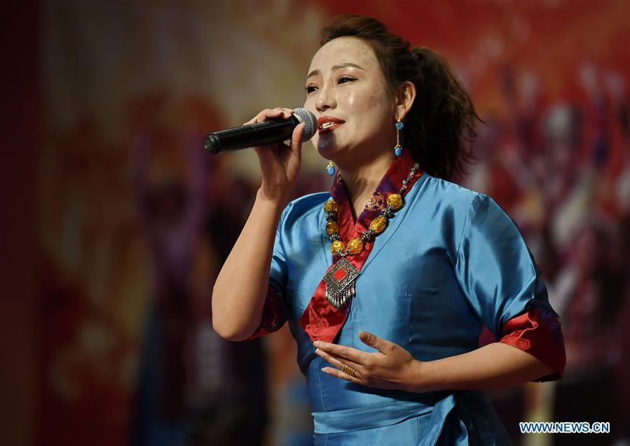 A singer sings during a performance to mark Tibet\'s Serfs\' Emancipation Day in Shannan, southwest China\'s Tibet Autonomous Region, March 26, 2019. Serfs\' Emancipation Day was formally established on March 28. (Xinhua/Zhang Rufeng)