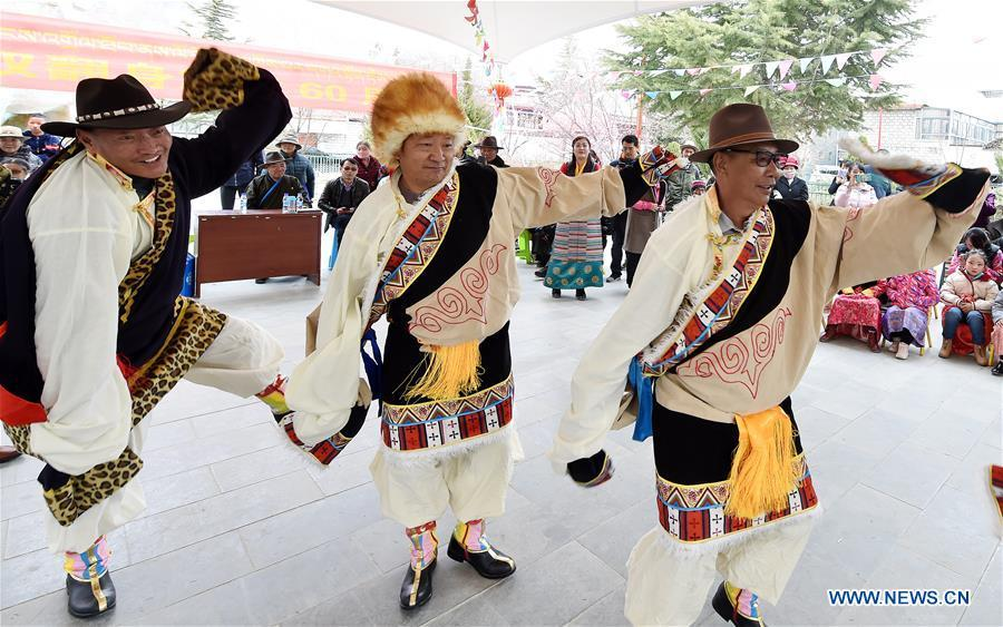 People dance to celebrate the 60th anniversary of democratic reforms in Tibet, at a community in Lhasa, capital of southwest China\'s Tibet Autonomous Region, March 23, 2019. (Xinhua/Chogo)