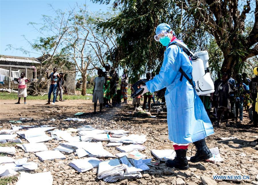 A member of Chinese rescue team carries out disinfection work in Lamago Village, 90 km from Beira, Mozambique, March 26, 2019. A Chinese rescue team went to Lamago Village to carry out disaster relief work on Tuesday. (Xinhua/Zhang Yu)