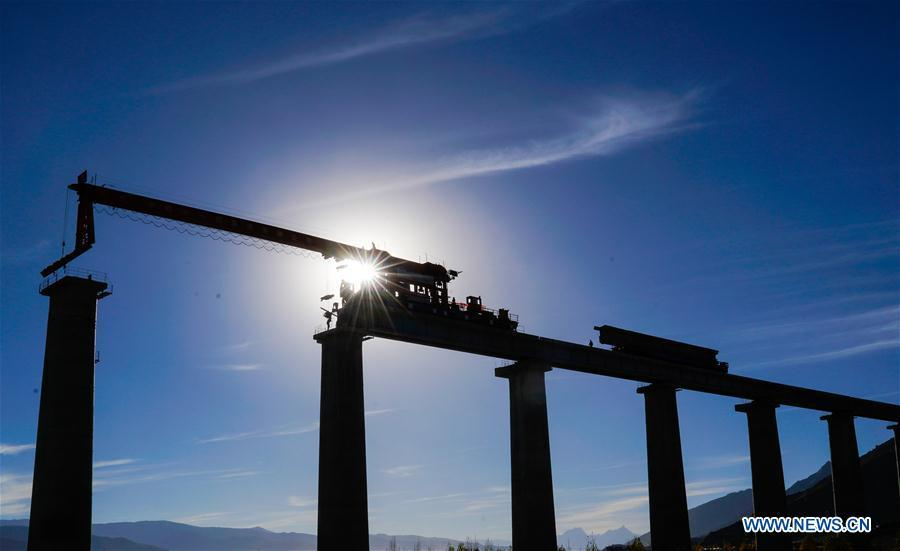 Photo taken on Oct. 16, 2018 shows construction site of Lhasa-Nyingchi railway in southwest China\'s Tibet Autonomous Region. Infrastructure has been improved in Tibet, as a comprehensive transportation network composed of highways, railways and air routes has been formed. (Xinhua/Purbu Zhaxi)