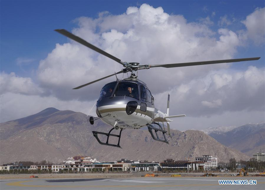 A tourism helicopter takes off in Lhasa, southwest China\'s Tibet Autonomous Region, March 20, 2019. Infrastructure has been improved in Tibet, as a comprehensive transportation network composed of highways, railways and air routes has been formed. (Xinhua/Jigme Dorje)