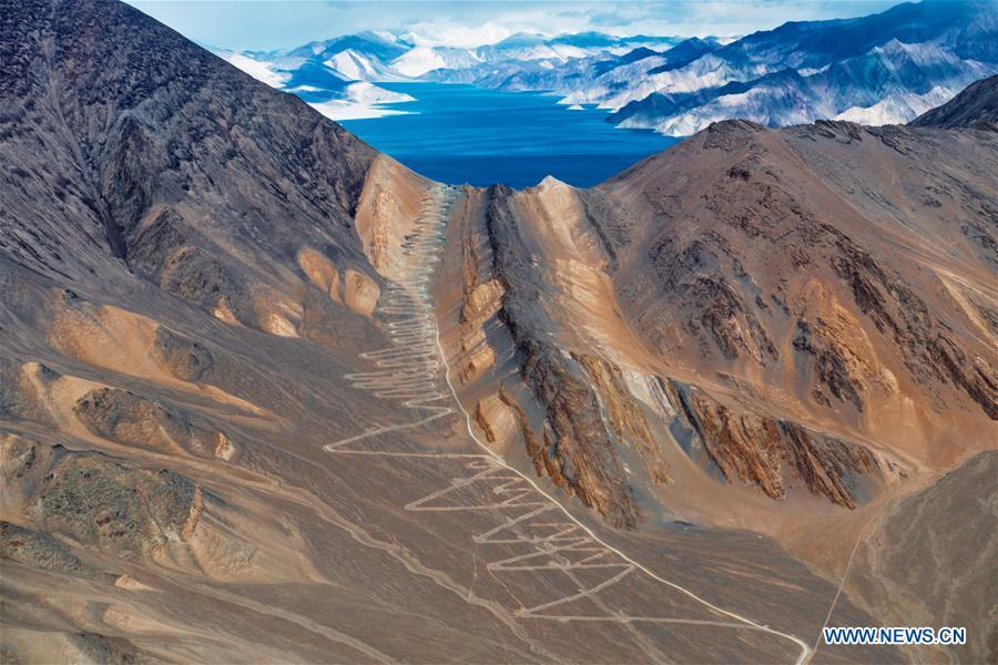 Photo taken on Nov. 9, 2015 shows a mountain road in Ali, southwest China\'s Tibet Autonomous Region. Infrastructure has been improved in Tibet, as a comprehensive transportation network composed of highways, railways and air routes has been formed. (Xinhua/Xiang Wenjun)