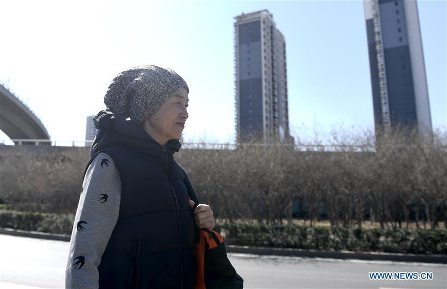 Bai Jinqin, a 74-year-old bodybuilding adept, walks home after exercising at a gym in north China\'s Tianjin, March 13, 2019. Bai has kept exercising for 14 years. After finishing her housework, Bai likes to spend one hour every day at the gym to build her body. The hobby has rewarded her with good physique and energy. (Xinhua/Yue Yuewei)