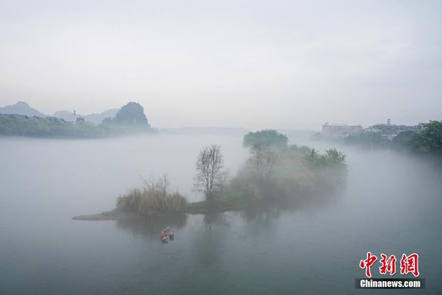 Downtown Guilin City covered in mist in Guangxi Zhuang Autonomous Region, March 28, 2019. Like a green ribbon flowing through the mountains, the Lijiang River is known for its amazing natural beauty. (Photo: China News Service/Tang Mengxian)