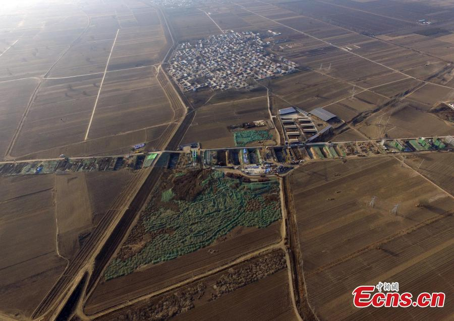An aerial view of construction in Xiongan New Area, Hebei Province, March 27, 2019. In April 2017, China announced the establishment of the Xiongan New Area, spanning three counties in Hebei Province about 100 km southwest of Beijing. Many of Beijing\'s non-capital functions, as well as some of its population, will be relocated to Xiongan. (Photo: China News Service/Han Bing)