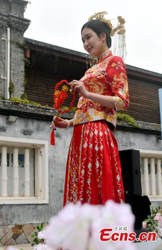 A wedding dress show held at the Three Lanes and Seven Alleys, a well-preserved architectural complex from the Ming and Qing dynasties in Fuzhou City, Fujian Province, March 31, 2019. Models from China and other countries presented wedding dresses that feature cultural traditions. (Photo: China News Service/Lyu Ming)