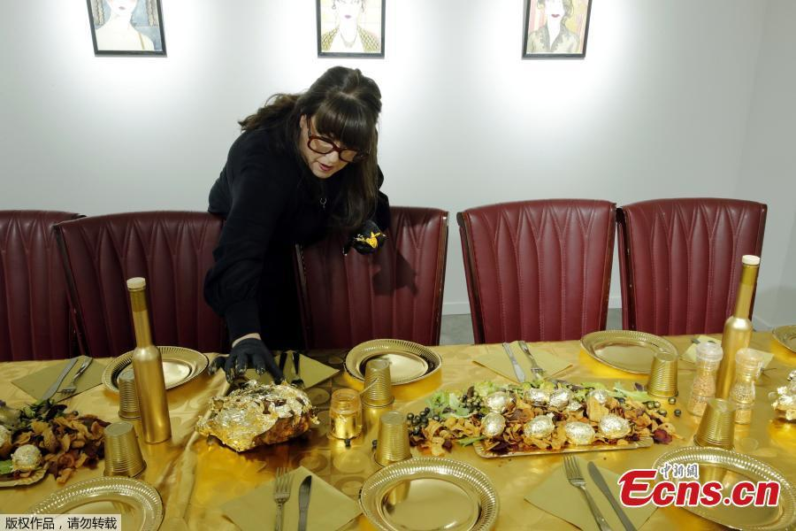 Artist and performer Frederique Lecerf prepares her performance meal for guests, a golden dinner with decadent 24 carat gold-covered dishes, in Paris, France, March 28, 2019. (Photo/Agencies)