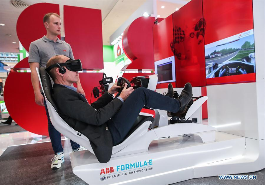 Photo taken on Apirl 1, 2019 shows cable car models displayed at the booth of PlusServer during the 2019 Hanover Fair in Hanover, Germany, on April 1, 2019. With a total of 6,500 exhibitors from 75 countries and regions, the Hanover Fair shows the latest development of technologies for industrial use, including 5G network, artificial intelligence, light-weight manufacturing, among others. (Xinhua/Shan Yuqi)