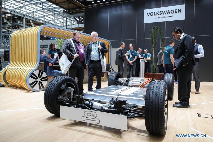 Visitors look at a chassis displayed at the booth of Volkswagen during the 2019 Hanover Fair in Hanover, Germany, on April 1, 2019. With a total of 6,500 exhibitors from 75 countries and regions, the Hanover Fair shows the latest development of technologies for industrial use, including 5G network, artificial intelligence, light-weight manufacturing, among others. (Xinhua/Shan Yuqi)