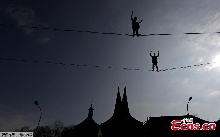 Tightrope walkers perform on ropes stretched over the Emmaus Monastery in Prague, Czech Republic, April 1, 2019.  (Photo/Agencies)