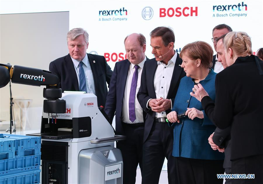 German Chancellor Angela Merkel (4th L) visits the booth of Bosch Rexroth during the 2019 Hanover Fair in Hanover, Germany, on April 1, 2019. With a total of 6,500 exhibitors from 75 countries and regions, the Hanover Fair shows the latest development of technologies for industrial use, including 5G network, artificial intelligence, light-weight manufacturing among others. (Xinhua/Shan Yuqi)