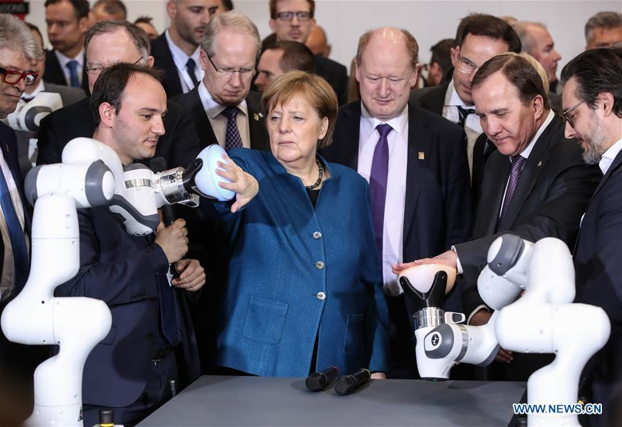 German Chancellor Angela Merkel (front C) and Swedish Prime Minister Stefan Loefven (2nd R, front) visit the booth of FRANKA EMIKA during the 2019 Hanover Fair in Hanover, Germany, on April 1, 2019. With a total of 6,500 exhibitors from 75 countries and regions, the Hanover Fair shows the latest development of technologies for industrial use, including 5G network, artificial intelligence, light-weight manufacturing among others. (Xinhua/Shan Yuqi)