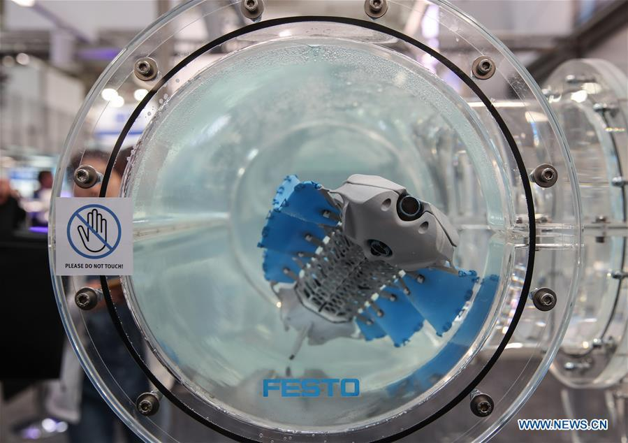 A bionic underwater robot is seen at the booth of Festo during the 2019 Hanover Fair in Hanover, Germany, on April 1, 2019. With a total of 6,500 exhibitors from 75 countries and regions, the Hanover Fair shows the latest development of technologies for industrial use, including 5G network, artificial intelligence, light-weight manufacturing among others. (Xinhua/Shan Yuqi)