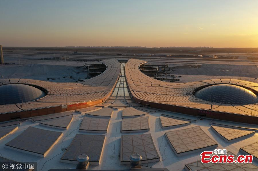 An outside view of the Beijing Daxing International Airport, which will be put into operation before September 30. The new airport sits at the junction of Beijing\'s southern Daxing District and Langfang, a city in Hebei Province. It is expected to handle 45 million passengers annually by 2021 and 72 million by 2025. (Photo/VCG)