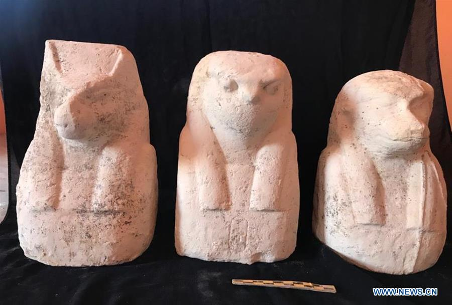 The undated photo provided by Egyptian Ministry of Antiquities on April 1, 2019 shows three small statues in Quesna city of Menoufia province, Egypt. An Egyptian archaeological mission uncovered a limestone-made coffin in Quesna city of Menouifia province, the country\'s Ministry of Antiquities said in a statement on Monday. \