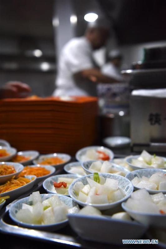 Photo taken on April 2, 2019 shows cold dishes at a beef noodle restaurant in Lanzhou, capital of northwest China\'s Gansu Province. Lanzhou beef noodles, a Chinese hand-pulled noodle originated in Lanzhou, has a history of about 100 years. There are about ten types of noodles of different width and shapes, depending on noodle chefs\' pulling skills. It has won fame both at home and abroad with its speciality of noodles and soup recipe. (Xinhua/Ma Ning)