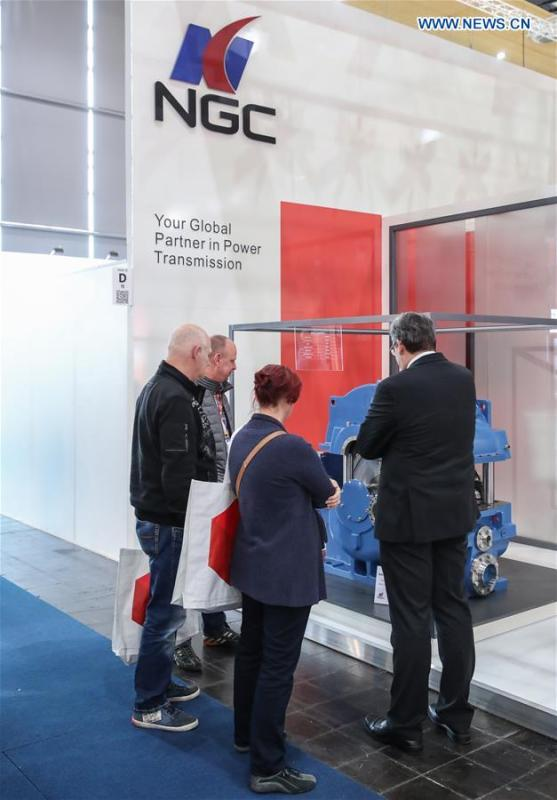 Visitors view an equipment displayed at the booth of Chinese wind power drive equipment manufacturer NGC at Hanover Fair 2019 in Hanover, Germany, April 2, 2019. Over 1,400 Chinese exhibitors attended the fair, the second most just after the host country Germany. Huawei, Haier and other Chinese manufacturers showed their most advanced networking and artificial intelligence technologies to the world. (Xinhua/Shan Yuqi)