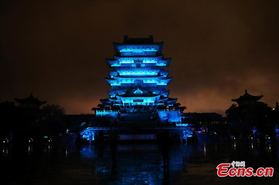 The historical Pavilion of Prince Teng is illuminated by blue lights during an event to mark World Autism Awareness Day, in Nanchang City, Jiangxi Province, April 2, 2019. The pavilion is on the east bank of the Ganjiang River and is one of the Three Great Towers of southern China. A total of 16 historical and cultural buildings in China took part in the light-up event to mark the day, which aims to raise awareness with Autism Spectrum Disorder throughout the world. (Photo: China News Service/Liu Zhankun)
