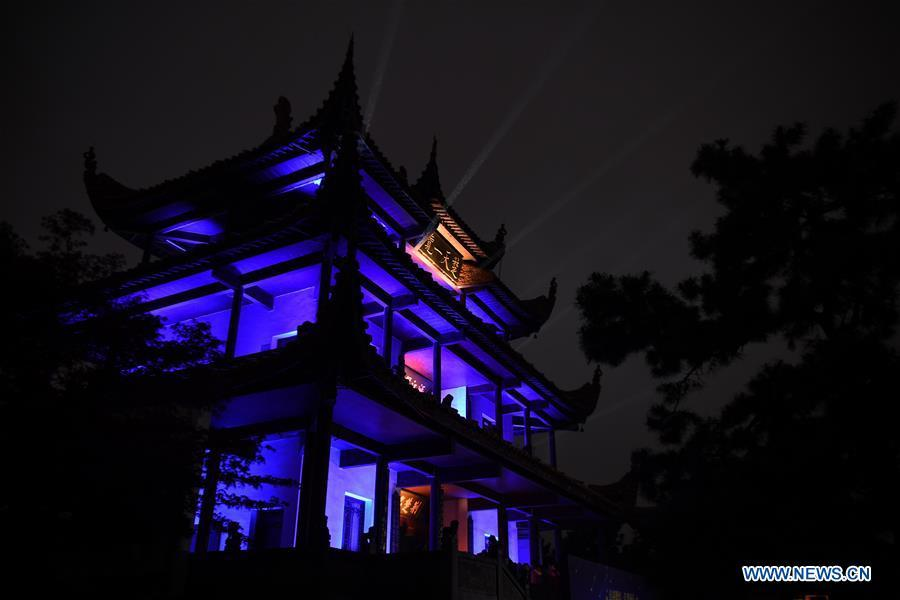 The Tianxin Pavilion is illuminated with blue colored lights to raise awareness about Autism Spectrum Disorder (ASD) in Changsha, capital of central China\'s Hunan Province, April 2, 2019, the World Autism Awareness Day. World Autism Awareness Day on April 2 every year is designated to encourage member states of the United Nations to take measures to raise awareness about people with ASD throughout the world. (Xinhua/Xue Yuge)