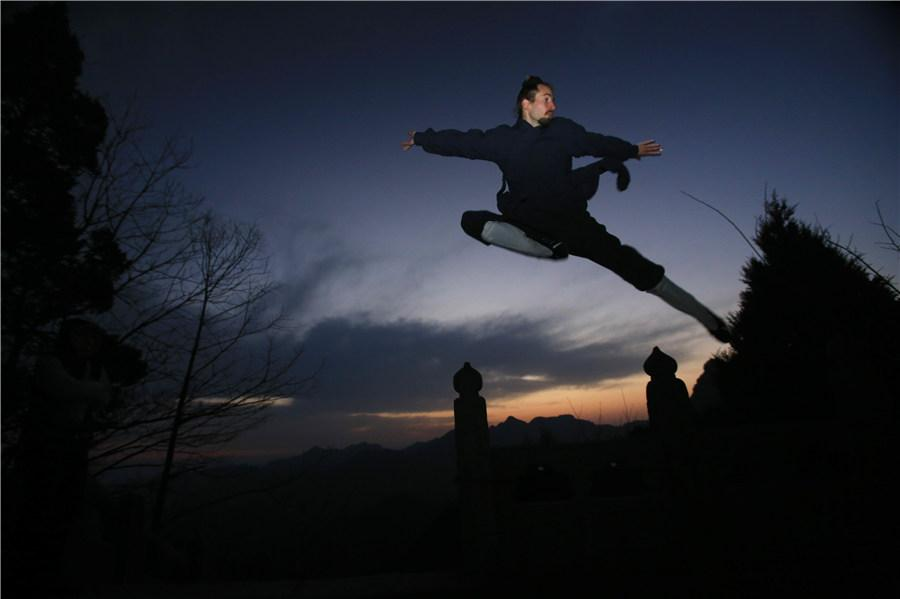 About 20 Chinese martial arts schools in the Wudang Mountain region have trained about 30,000 kung fu enthusiasts from around the world. (Photo provided to chinadaily.com.cn)