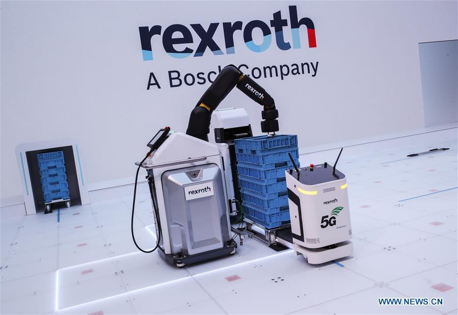 Robots utilizing 5G network are displayed at the booth of German-based drive and control company Bosch Rexroth during the 2019 Hanover Fair in Hanover, Germany, April 2, 2019. (Xinhua/Shan Yuqi)