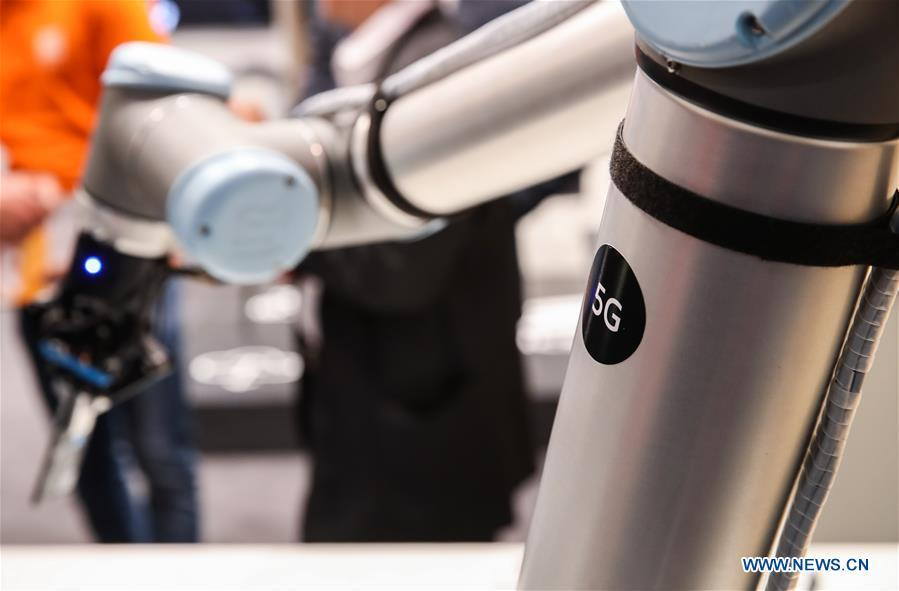 A robotic arm utilizing 5G network is displayed at the booth of Ericsson during the 2019 Hanover Fair in Hanover, Germany, April 2, 2019. (Xinhua/Shan Yuqi)