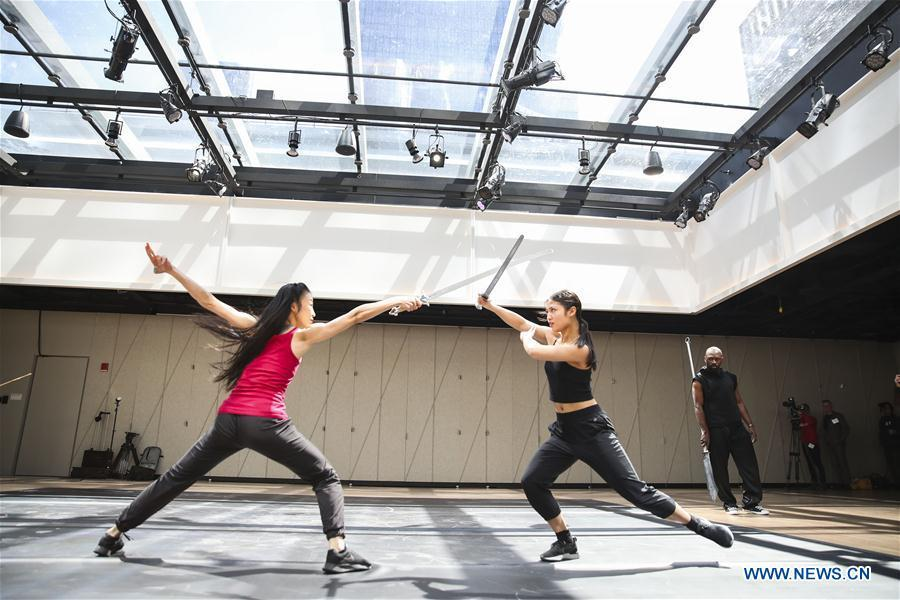 Performers rehearse during a media preview in The Shed, a new arts center in New York, the United States, on April 3, 2019. The Shed, New York City\'s new arts center that commissions, develops, and presents original works of art, across all disciplines, for all audiences, will open to the public on April 5 with the world premiere of Soundtrack of America. (Xinhua/Wang Ying)