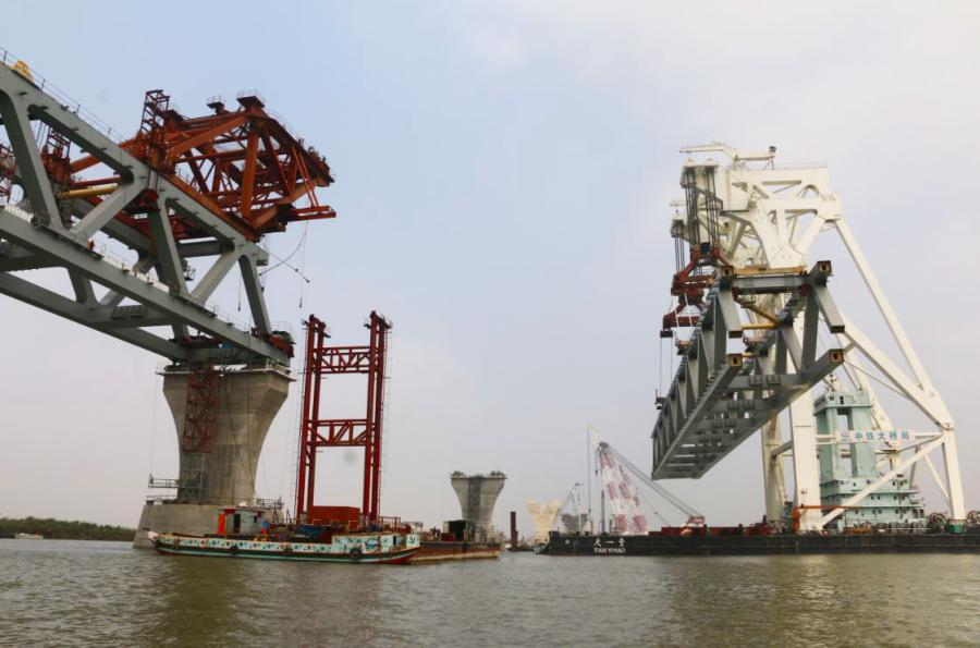 Construction of the core part of the Padma Bridge over the Padma River in Bangladesh is underway by China Railway Major Bridge Engineering Group Co Ltd on Feb. 21, 2019. (Photo/Xinhua) The Padma Bridge, 25 meters in width and 10 km in length, will be built over the Padma River, one of the three major rivers in Bangladesh.  In June 2016, China Railway Major Bridge Engineering Group Co Ltd was awarded a $1.55-billion contract by the Bangladeshi government to build the core structure of the bridge.  The bridge is the country\'s largest infrastructure project, as well as the largest foreign bridge project undertaken by Chinese companies in terms of total cost.  Once completed, travel time between the capital, Dhaka, and the southern city of Khulna will be shortened to about three hours from 13 hours.