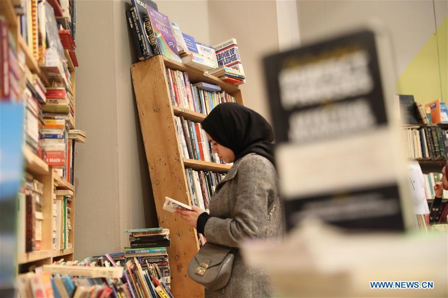 A woman visits the Alexandria International Book Fair in Alexandria, Egypt, March 31, 2019. The 15th Alexandria International Book Fair, the second largest exhibition in Egypt, witnessed a high visitor turnout, surprising officials of Bibliotheca Alexandria, the organizing body of the two-week event. (Xinhua/Ahmed Gomaa)