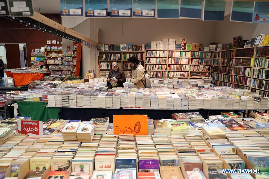 People visit the Alexandria International Book Fair in Alexandria, Egypt, March 31, 2019. The 15th Alexandria International Book Fair, the second largest exhibition in Egypt, witnessed a high visitor turnout, surprising officials of Bibliotheca Alexandria, the organizing body of the two-week event. (Xinhua/Ahmed Gomaa)