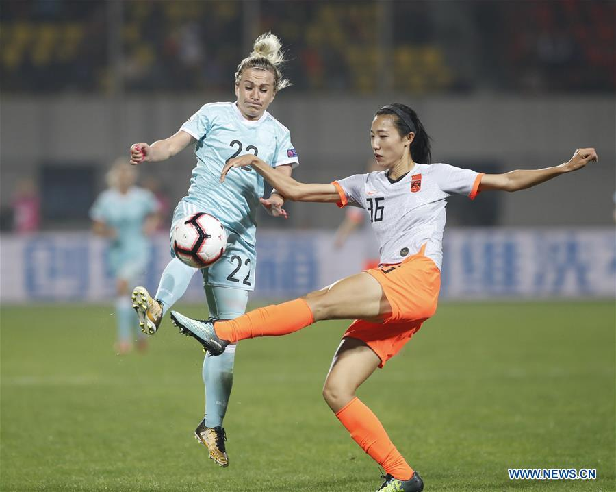 Lin Yuping (R) of China vies with Nelli Korovkina of Russia during the match between China and Russia at the 2019 International Women\'s Football Tournament in Wuhan, central China\'s Hubei Province, April 4, 2019. China won 4-1. (Xinhua/Ding Xu)