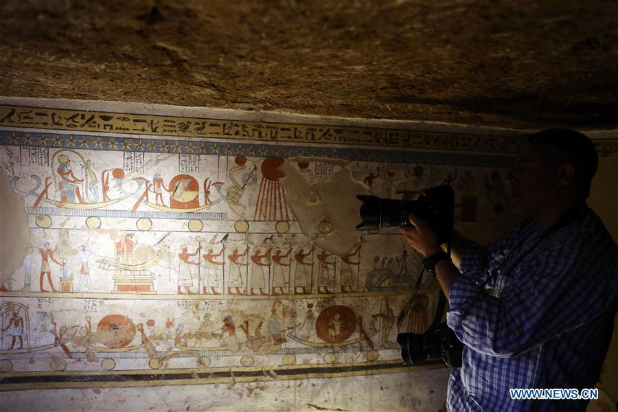A man takes photos at the site of a tomb in Sohag, Egypt, April 5, 2019. The Egyptian Minister of Antiquities announced on Friday the discovery of a tomb, dating back to the Ptolemaic era which spans from 305 BC to 30 BC, in Sohag province south of the capital Cairo. (Xinhua/Ahmed Gomaa)