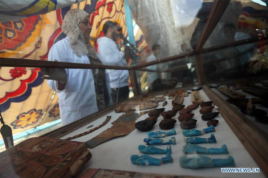 Photo taken on April 5, 2019 shows the antiquities discovered in a tomb in Sohag, Egypt. The Egyptian Minister of Antiquities announced on Friday the discovery of a tomb, dating back to the Ptolemaic era which spans from 305 BC to 30 BC, in Sohag province south of the capital Cairo. (Xinhua/Ahmed Gomaa)