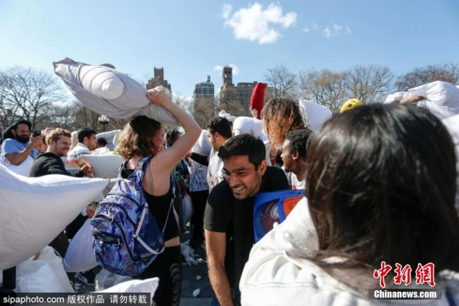 Participants take part in New York City\'s annual Pillow Fight Day in Washington Square Park on April 6, 2019. People engaged in friendly battle with each other during the event. (Photo/SipaPhoto)