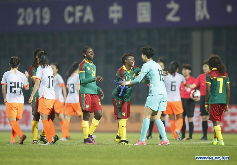 China\'s goalkeeper Bi Xiaolin (front R) greets Cameroon\'s Christine Manie (C front) after the final match between China and Cameroon at the 2019 International Women\'s Football Tournament in Wuhan, central China\'s Hubei Province, April 7, 2019. China won 1-0. (Xinhua/Ding Xu)