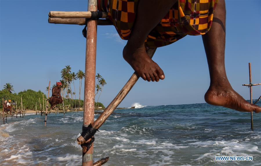 Stilt fishermen are seen at a beach in Galle, Sri Lanka, April 7, 2019. Stilt fishing is a method of fishing unique to the island country of Sri Lanka. Local fishermen sit on a crossbar called \