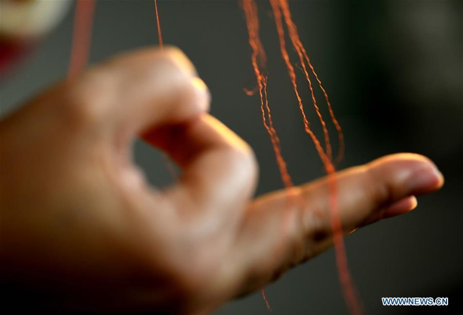 Craftswoman Liu Yuxia demonstrates embroidery skills at her studio in Qiaoxi District of Shijiazhuang, north China\'s Hebei Province, April 4, 2019. Liu Yuxia is an inheritor of Xu embroidery, which was listed as one of Shijiazhuang\'s intangible cultural heritages in 2018. Based on traditional Chinese embroidery skills, her works of unique style present the integration of Chinese and western painting techniques and photography. (Xinhua/Chen Qibao)